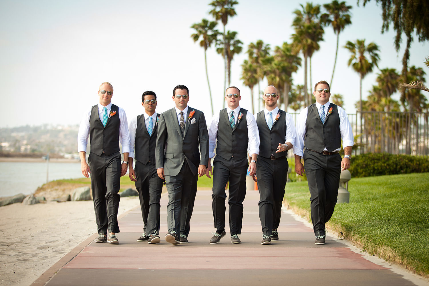 groomsmen walking on beach hilton mission bay