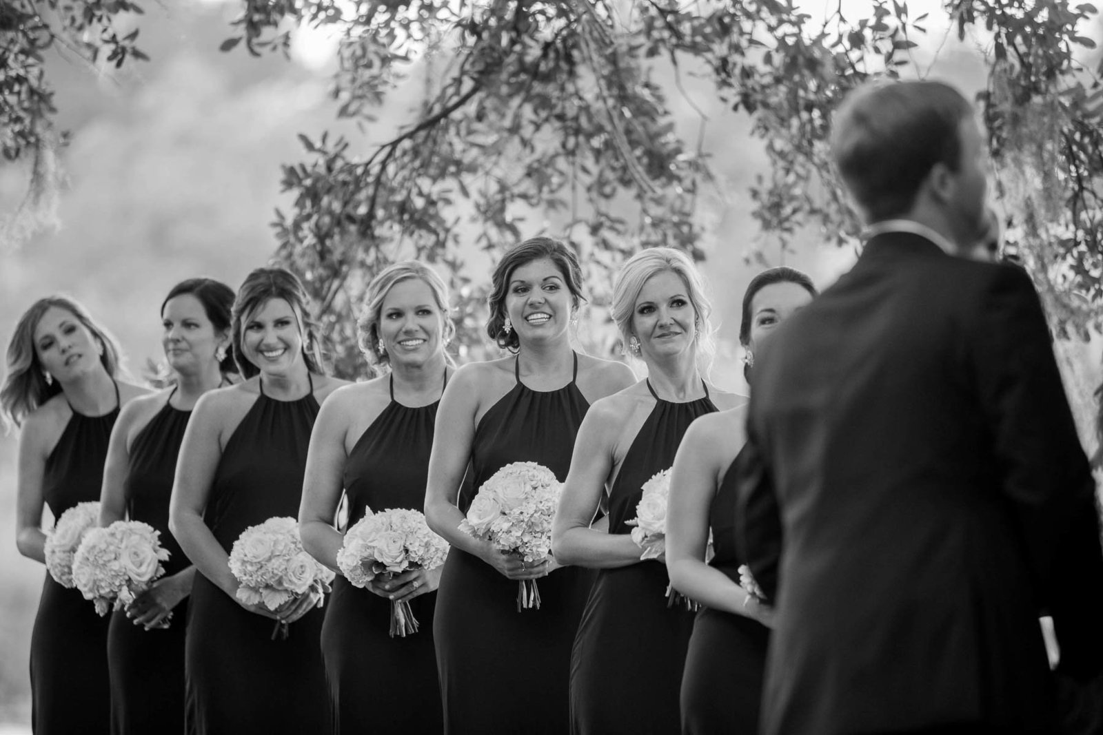 Bridesmaids stand in a row, Dunes West Golf and River Club, Charleston wedding photography.