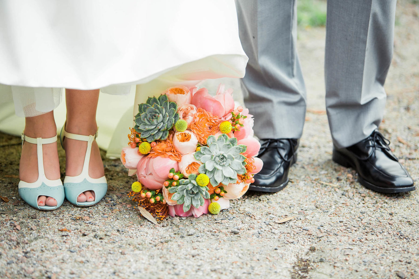 Bouquet is set between bride and groom's shoes, I'on Creek Club, Mt Pleasant, South Carolina