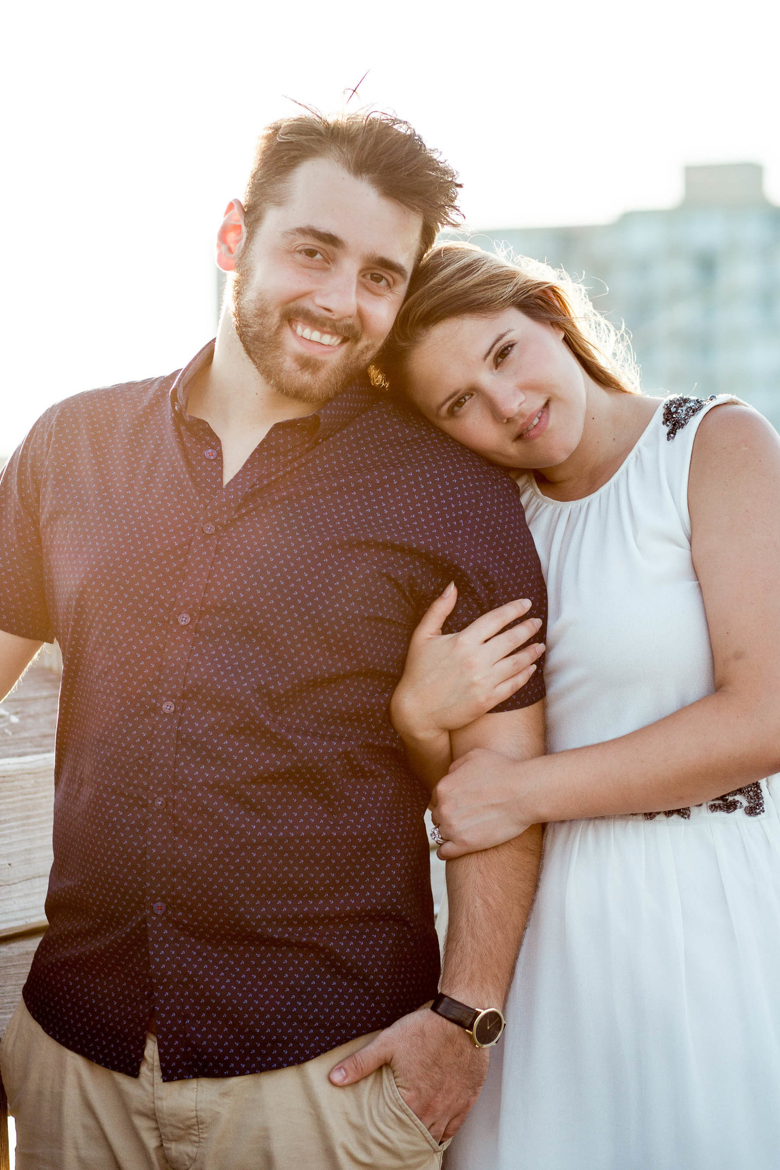 Engaged Couple on fishing pier, Folly beach, Charleston engagement photography.
