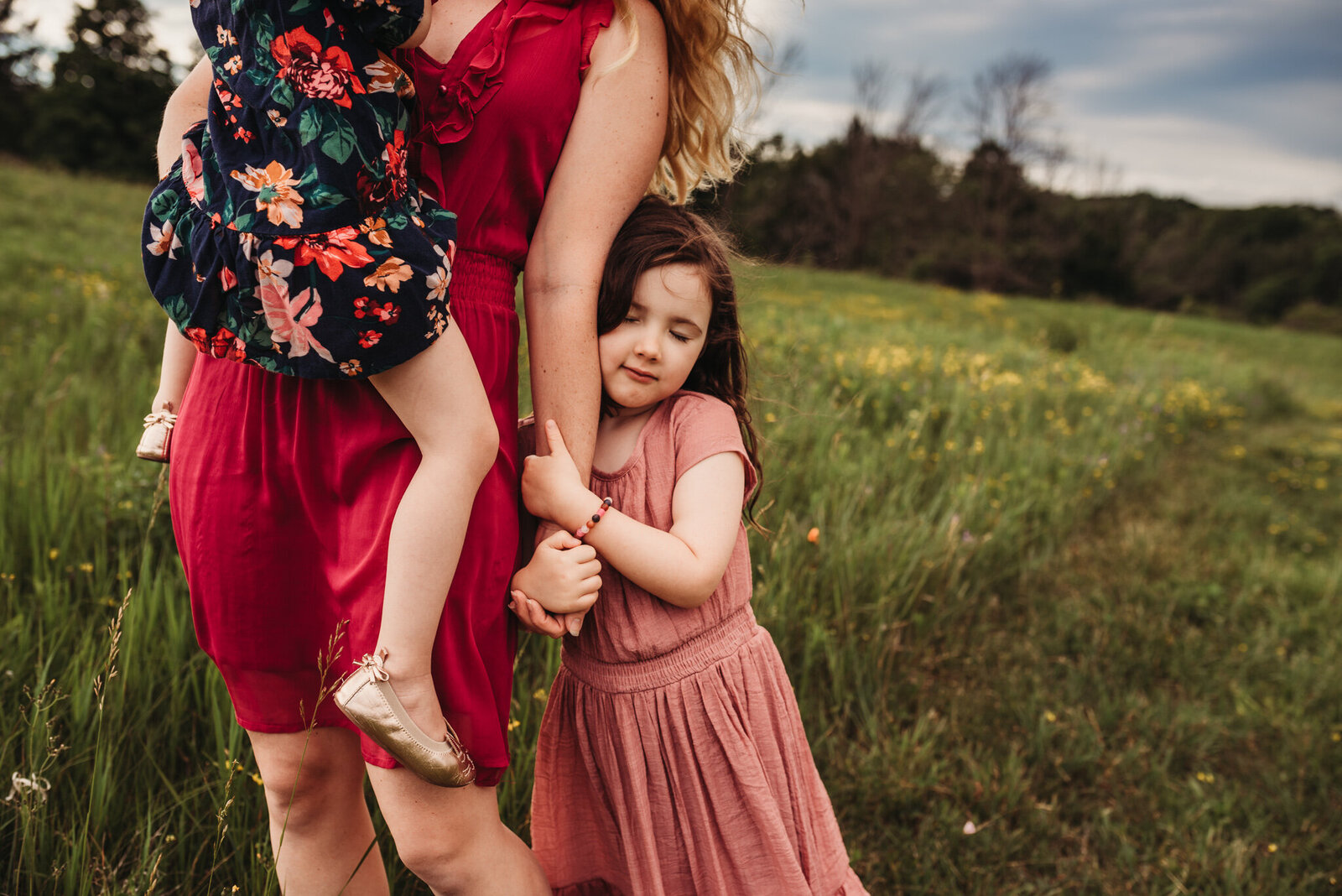 Young girl holding on to her mother's arm at Country Cut Flowers in Newmarket
