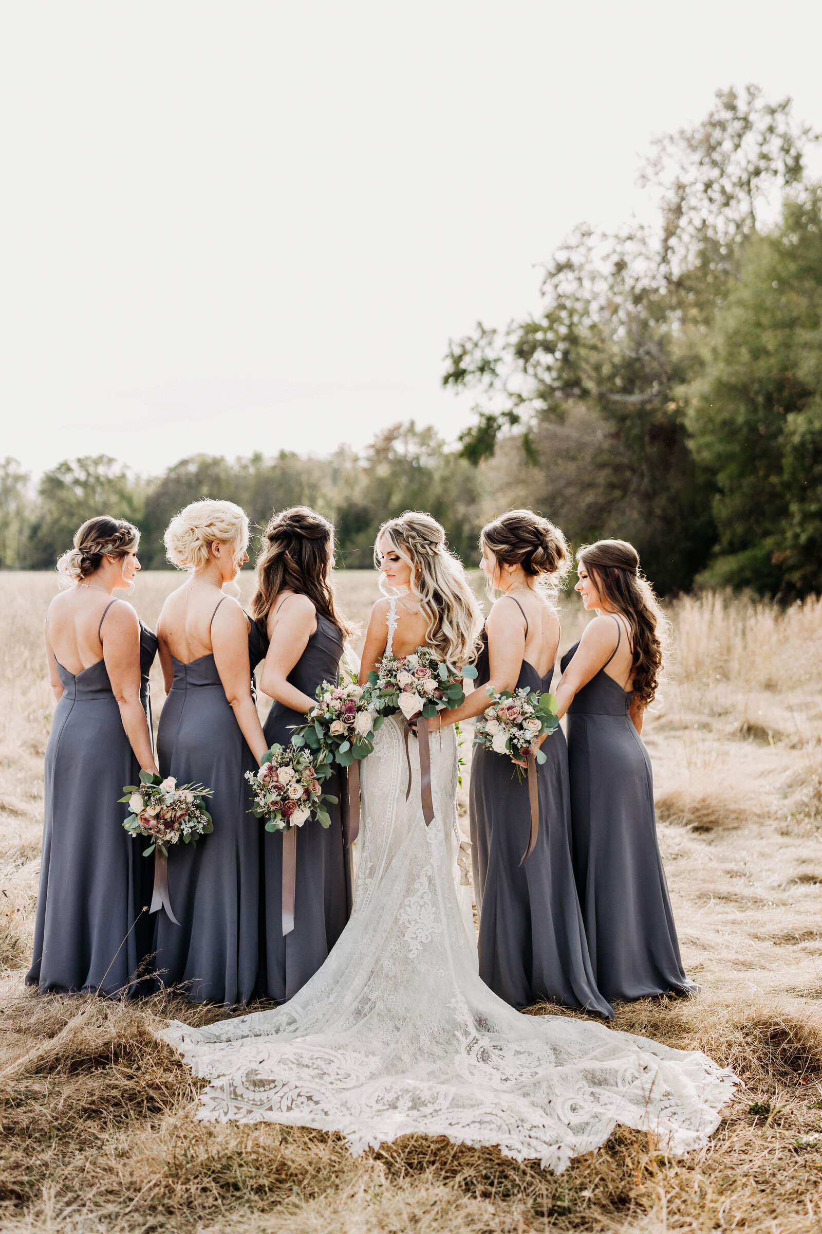 bridesmaids in field grove at centerton