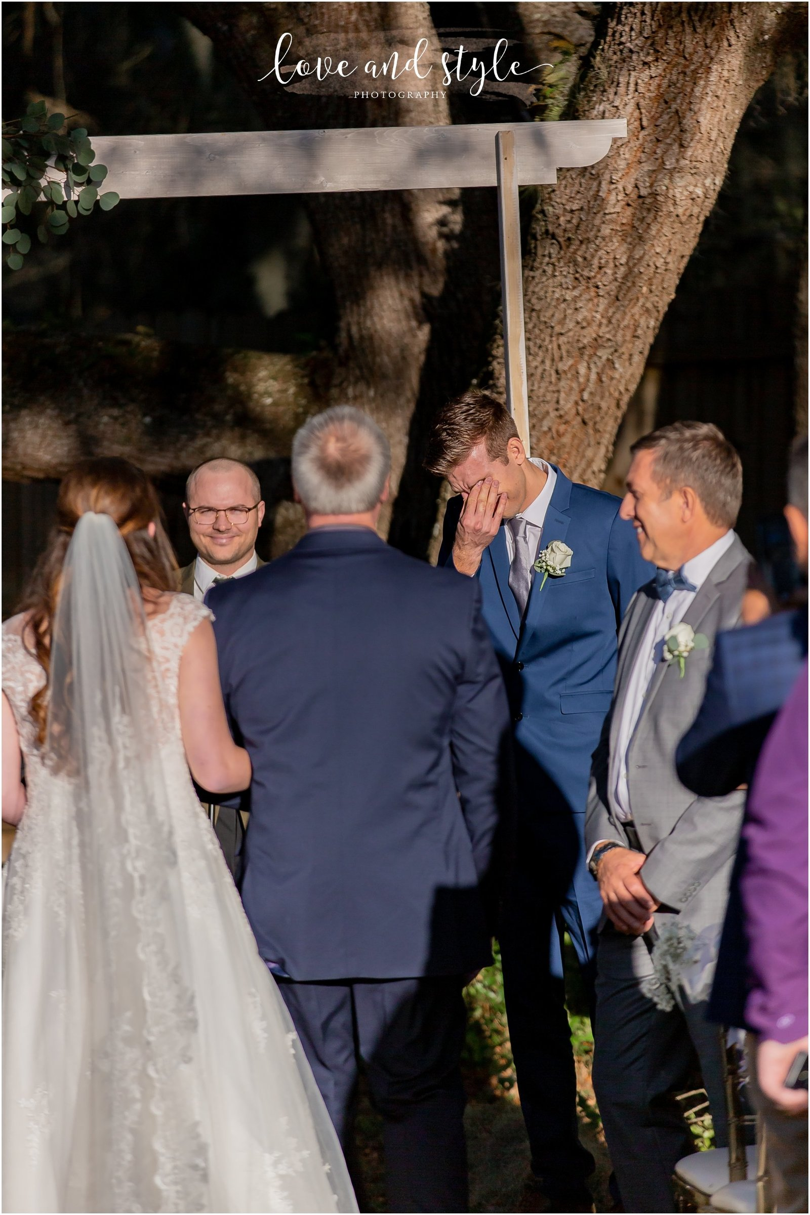 Groom sees his bride walking down the aisle at The Barn at Chapel Creek in Venice, Florida