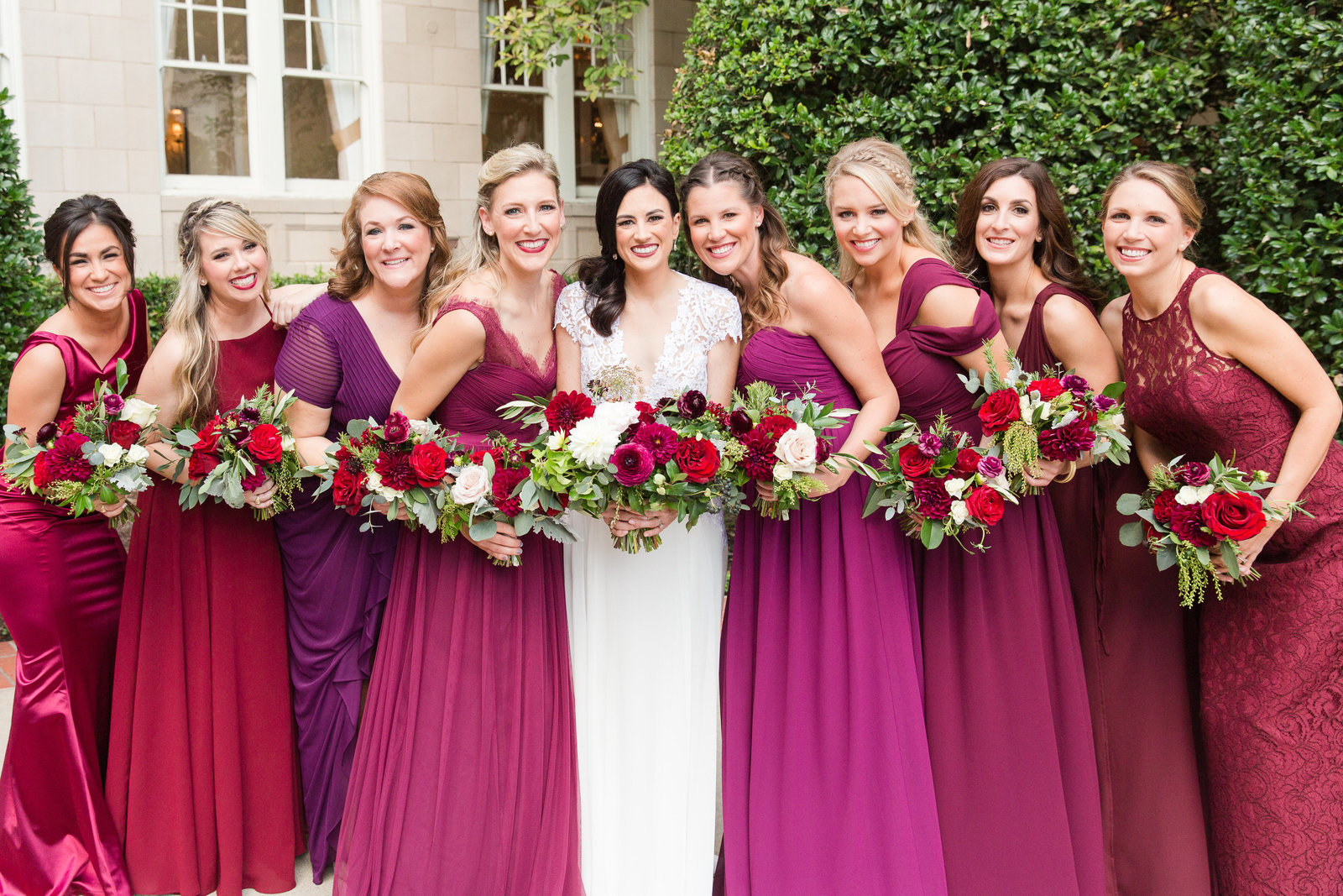 bridesmaids in mismatched dresses of wine and burgundy