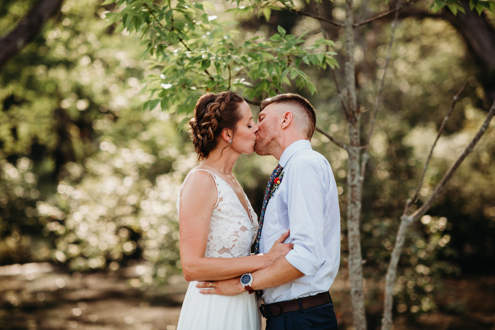 bride and groom kiss during outdoor summer wedding in massachusetts