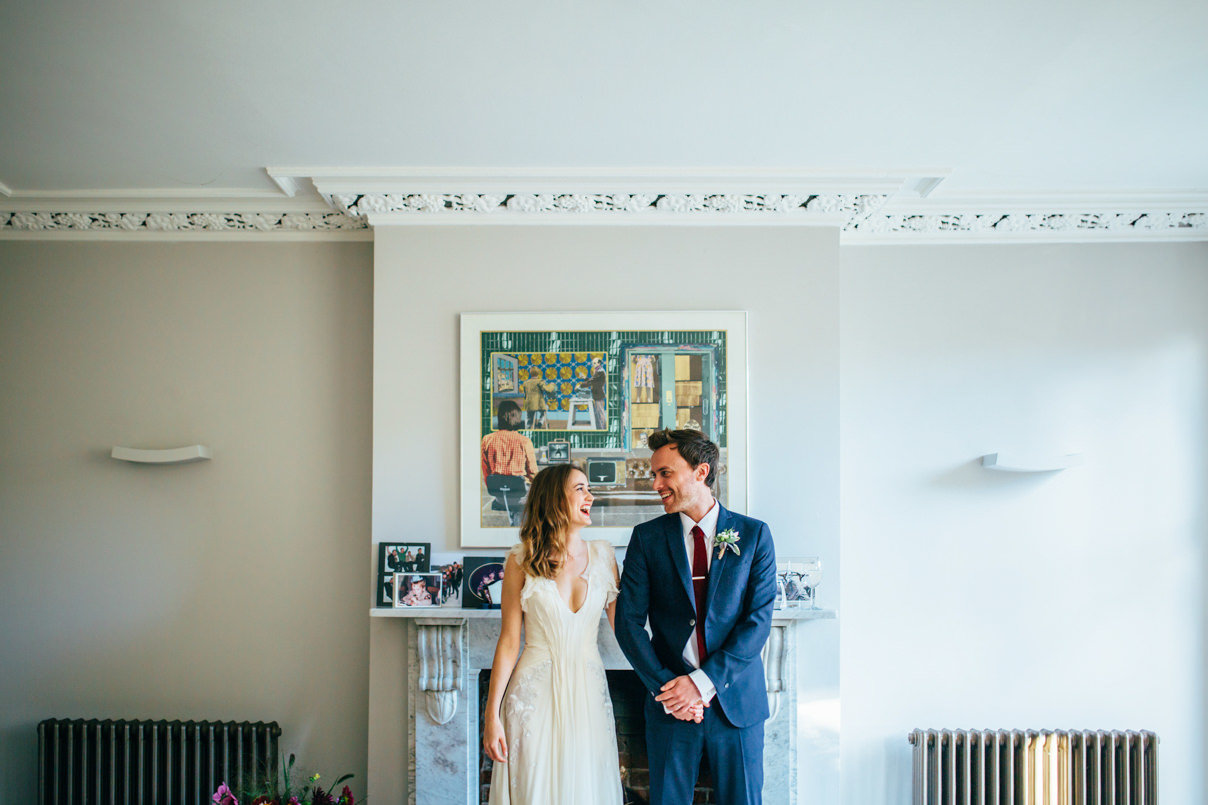 Relaxed Photograph of Suffolk Wedding Couple Laughing indoors