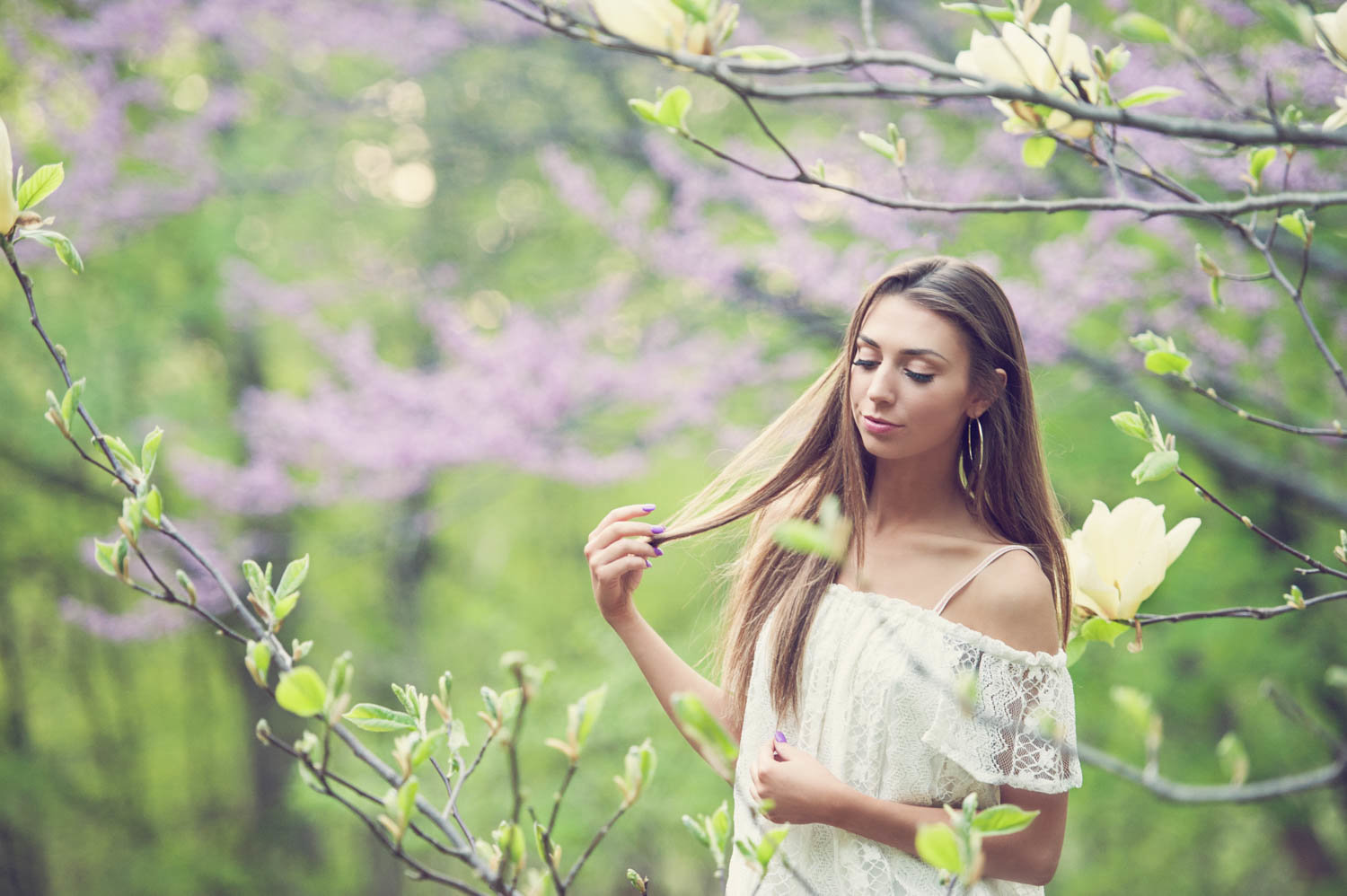 Spring nature senior photo of girl with trees and flowers