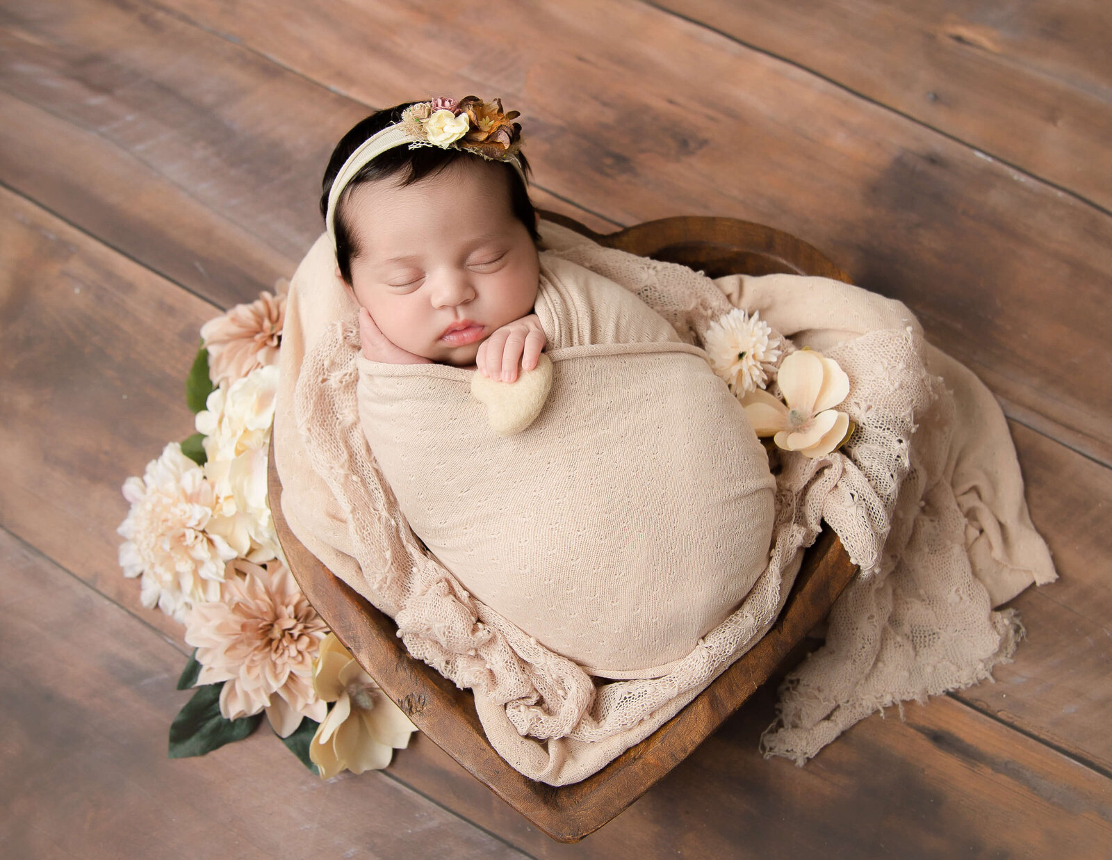 Precious newborn girl posed at our in-home studio in Rochester, NY.