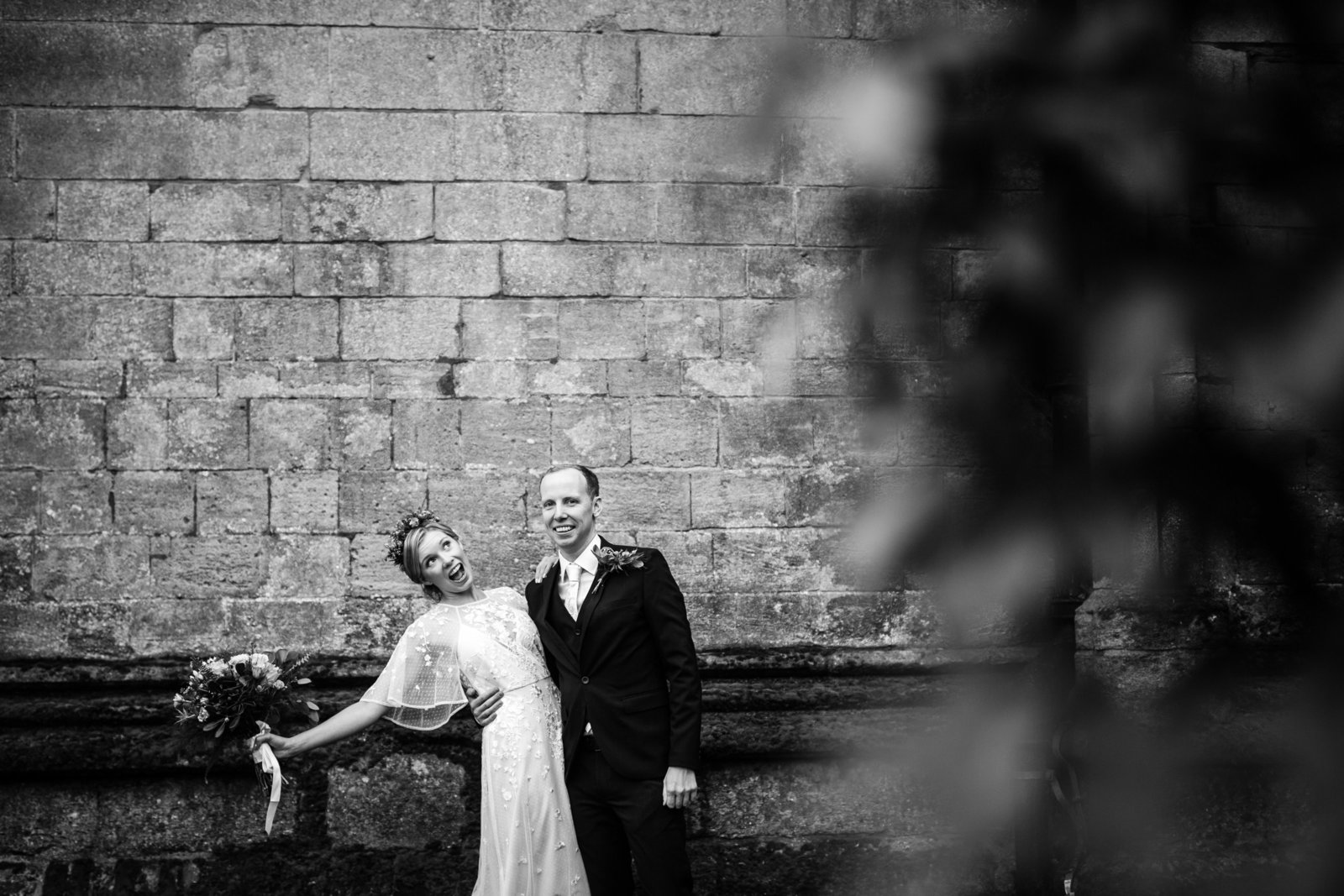 Bride and Groom strike happy pose for their wedding photographer in Bury St Edmunds, Suffolk.