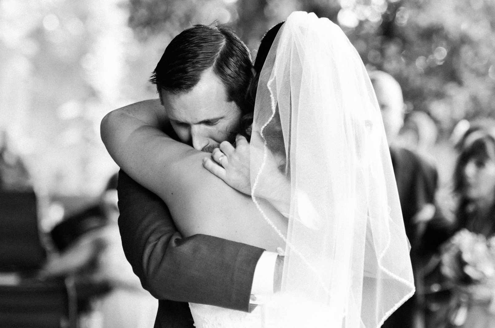 Green Valley Quail Creek Golf Club Wedding Black and White Photo of Bride and Groom Hugging | Tucson Wedding Photographer | West End Photography