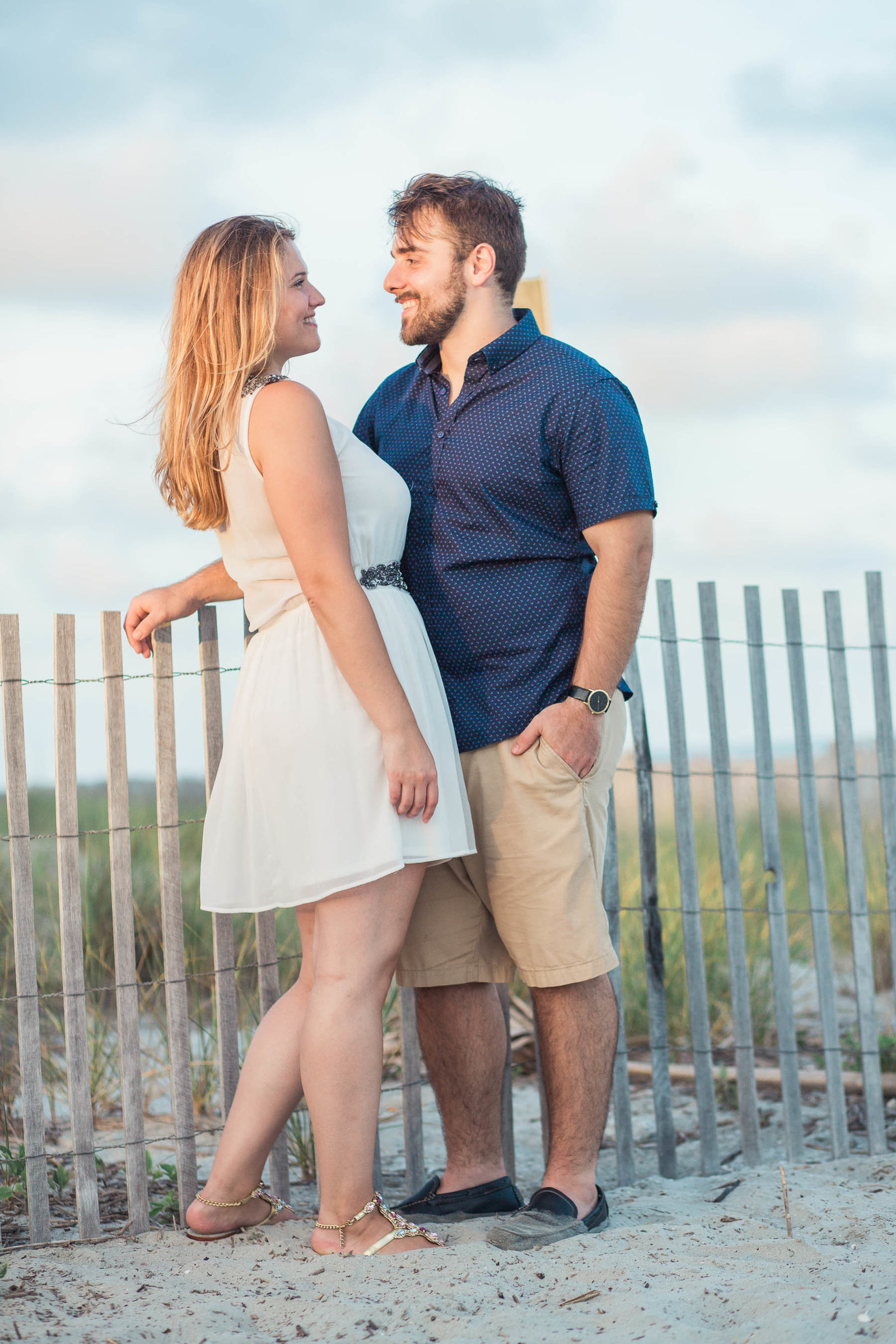 Engaged Couple by the dunes at sunset, Folly beach in Charleston, South Carolina