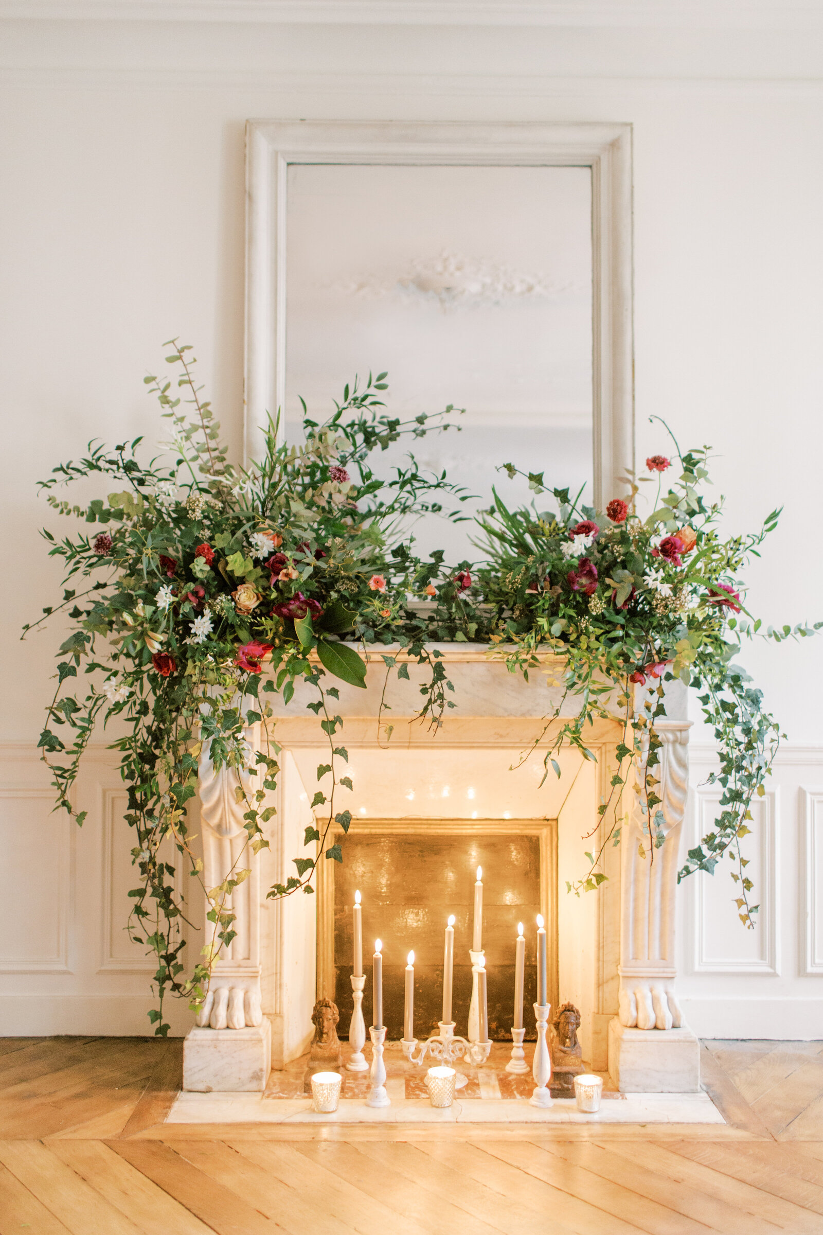 fireplace mantel with candles and flowers