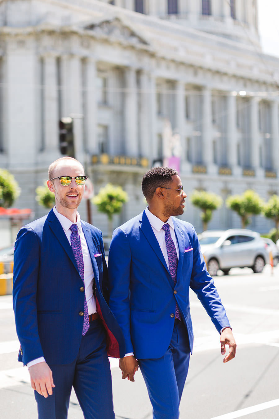 just married city hall couple crossing van ness street san francisci
