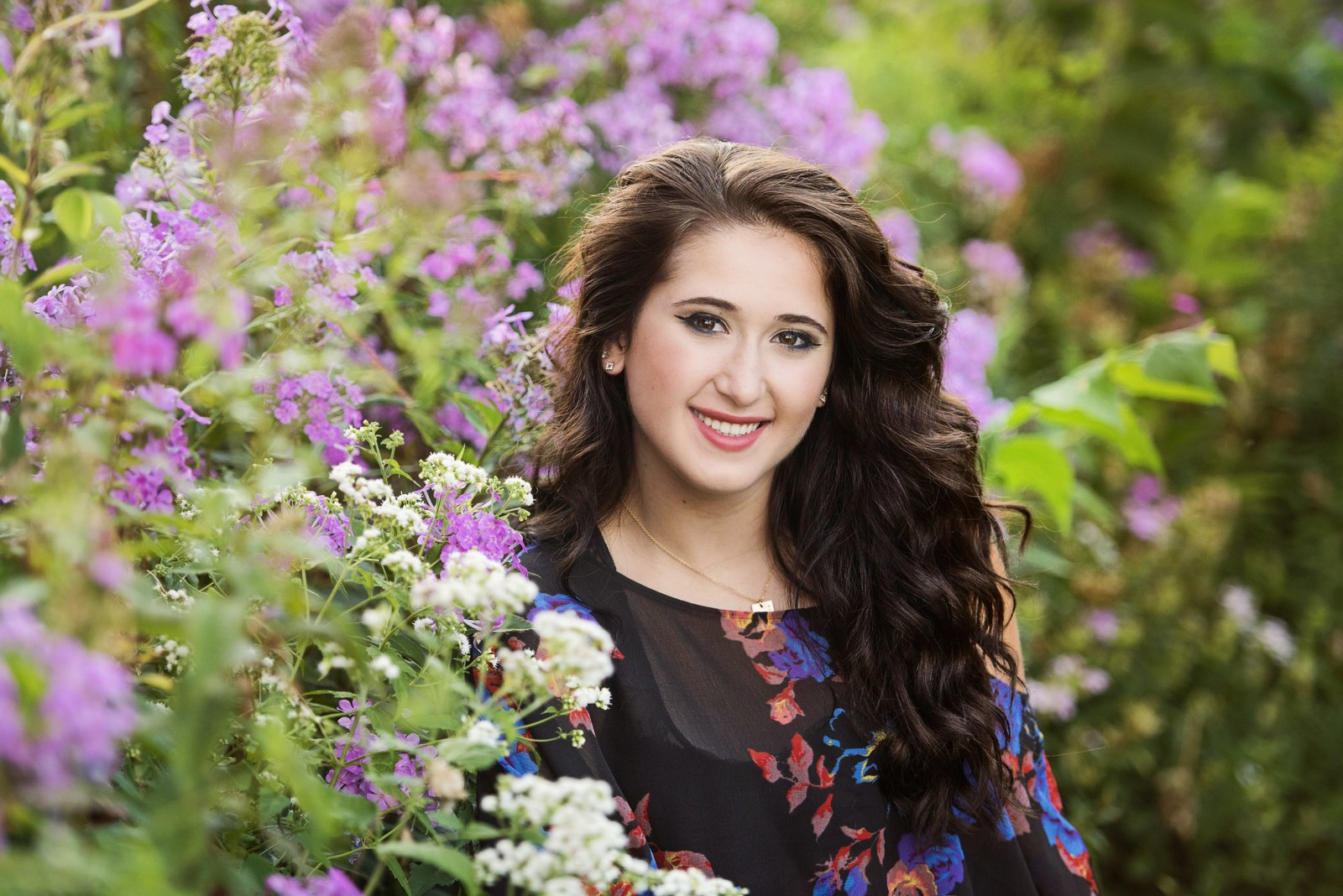 Senior picture of brunette girl with purple flowers