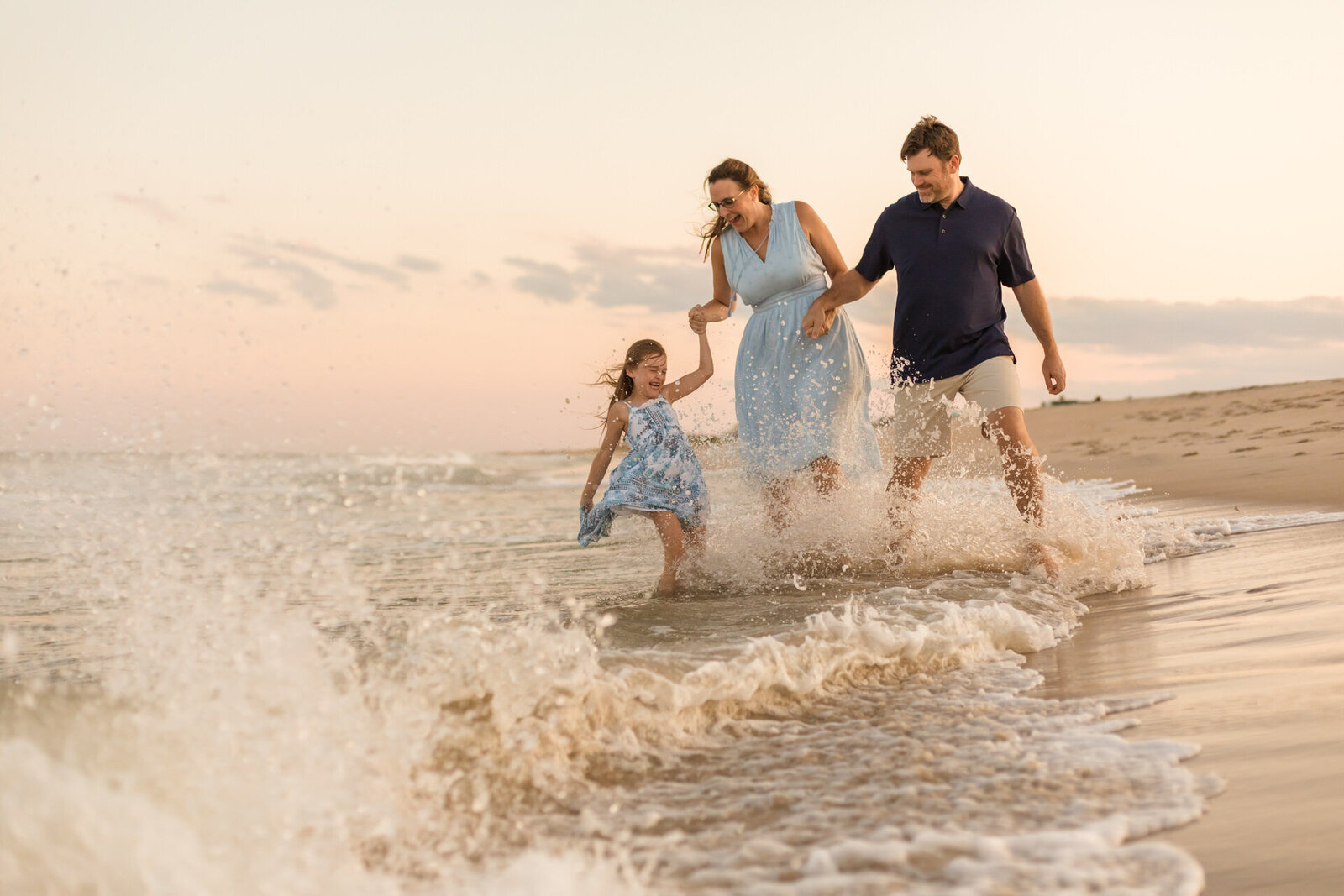Beach Laughing Family of Three Lifestyle Photo