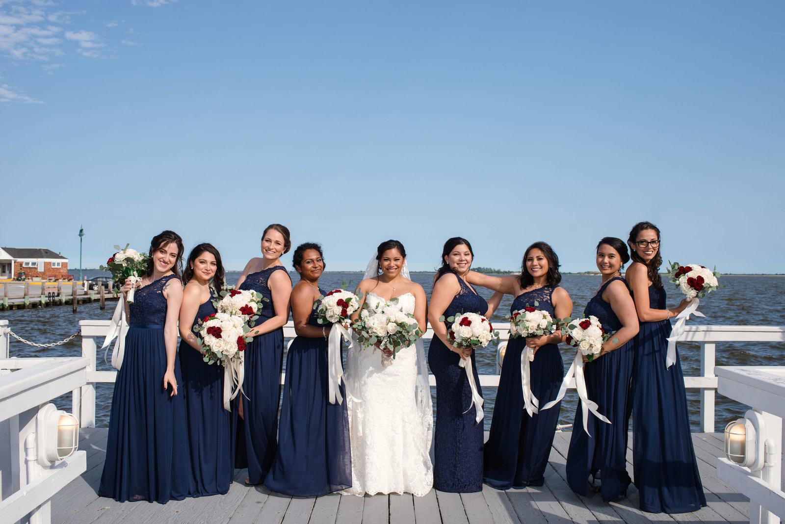 Bride and bridesmaids on dock