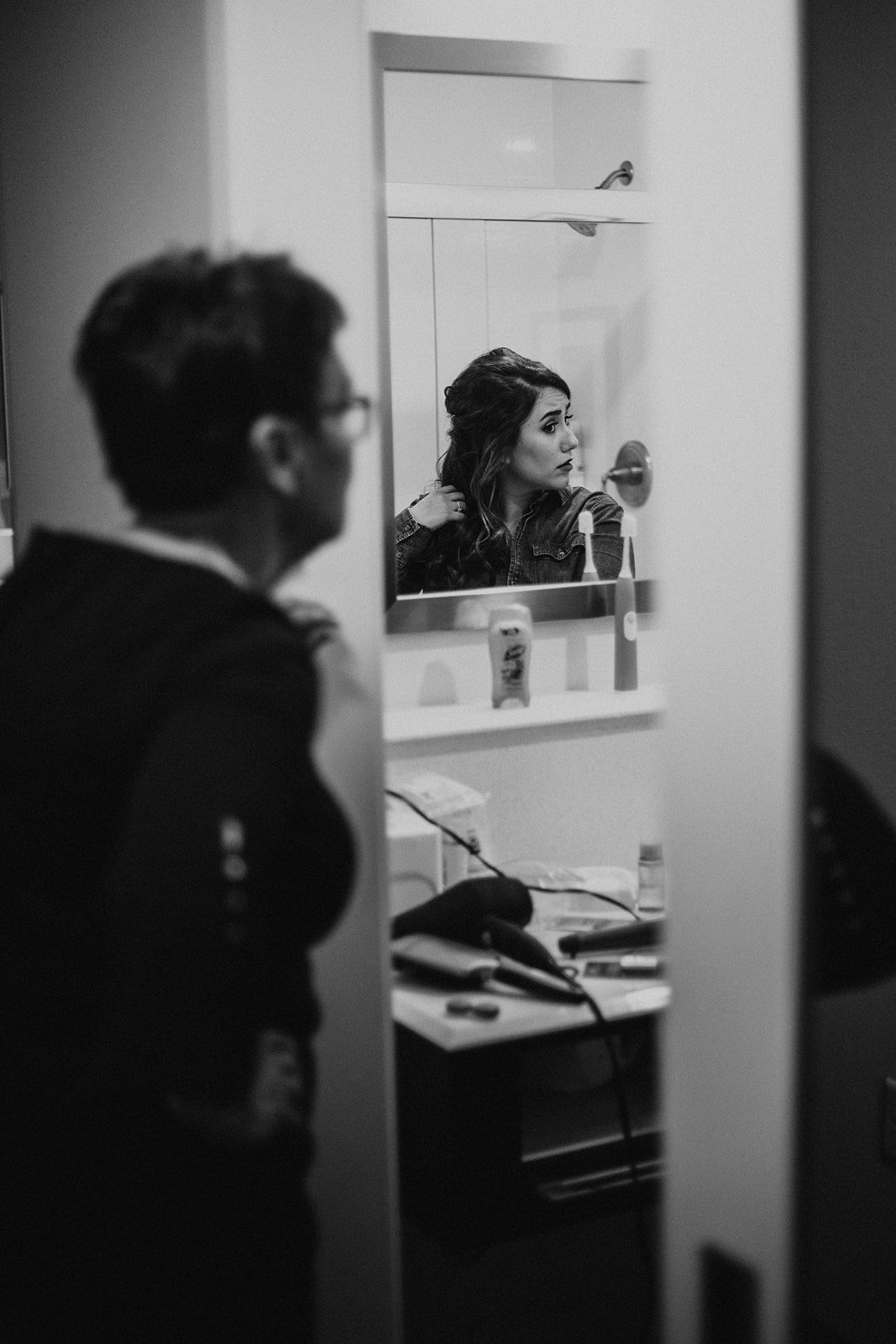 Bride getting ready in the bathroom on her Minneapolis wedding day