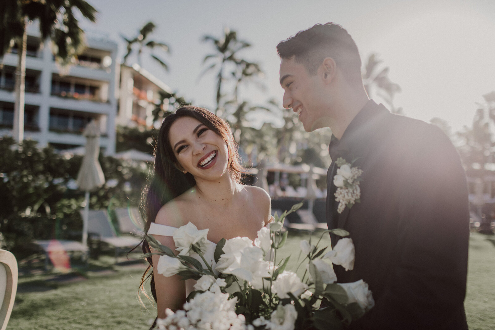 Bride-and-groom-laughing-in-front-of-four-seasons-hotel