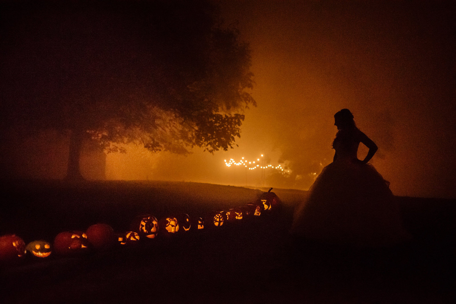Bride with pumpkins. Halloween wedding at East Riddlesden Hall. Fine art wedding photographer