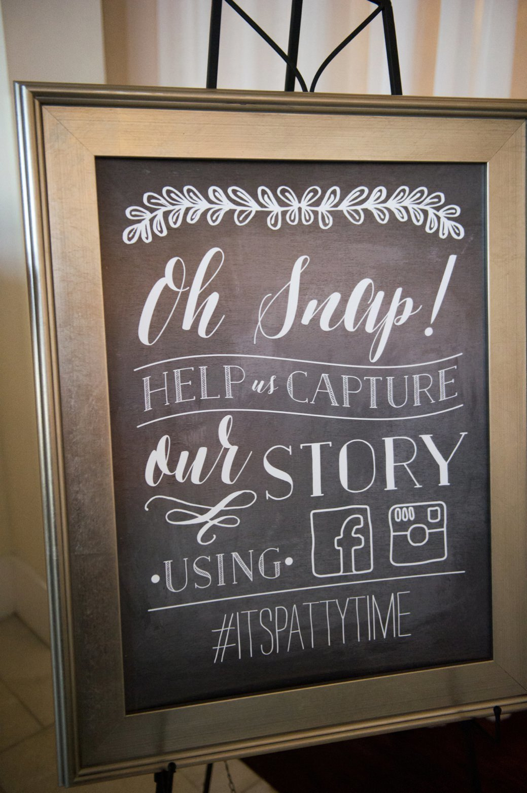 Wedding hashtag sign on a gold framed chalkboard