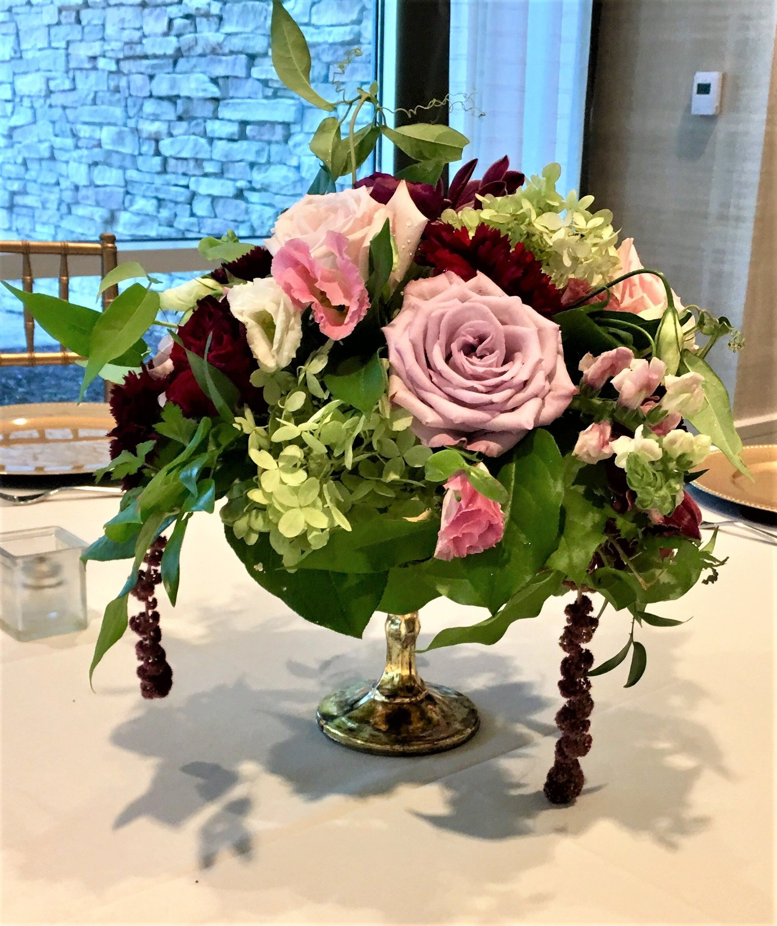 Reception centerpiece with mauve roses and burgundy amaranthus