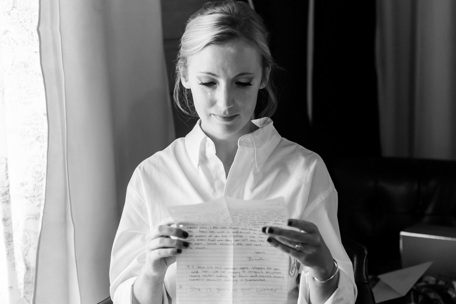 bride crying reading letter on wedding day at hermitage hill farm and stables by waynesboro virginia photographer