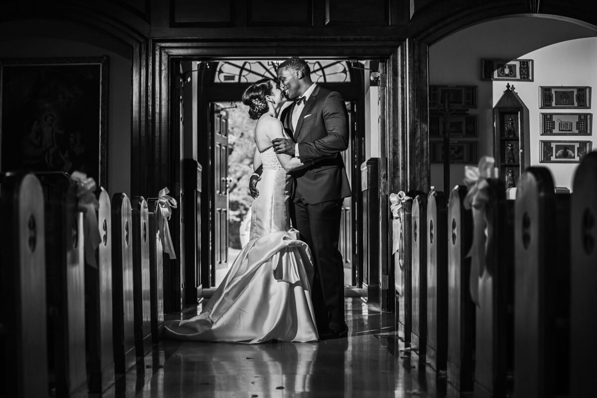 black and white of a bride and groom at St. Josephs on the Brandywine