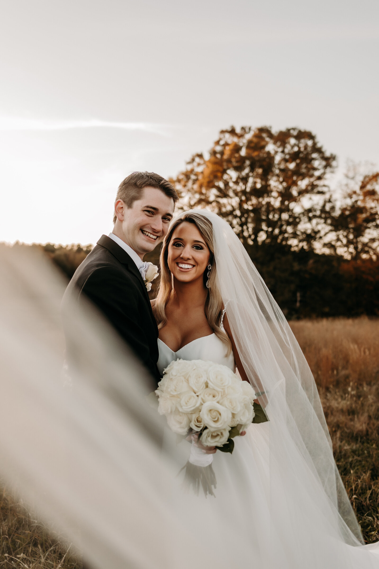 J.Michelle Photography photographs bride and groom at vintage oaks farm wedding in Athens, Ga