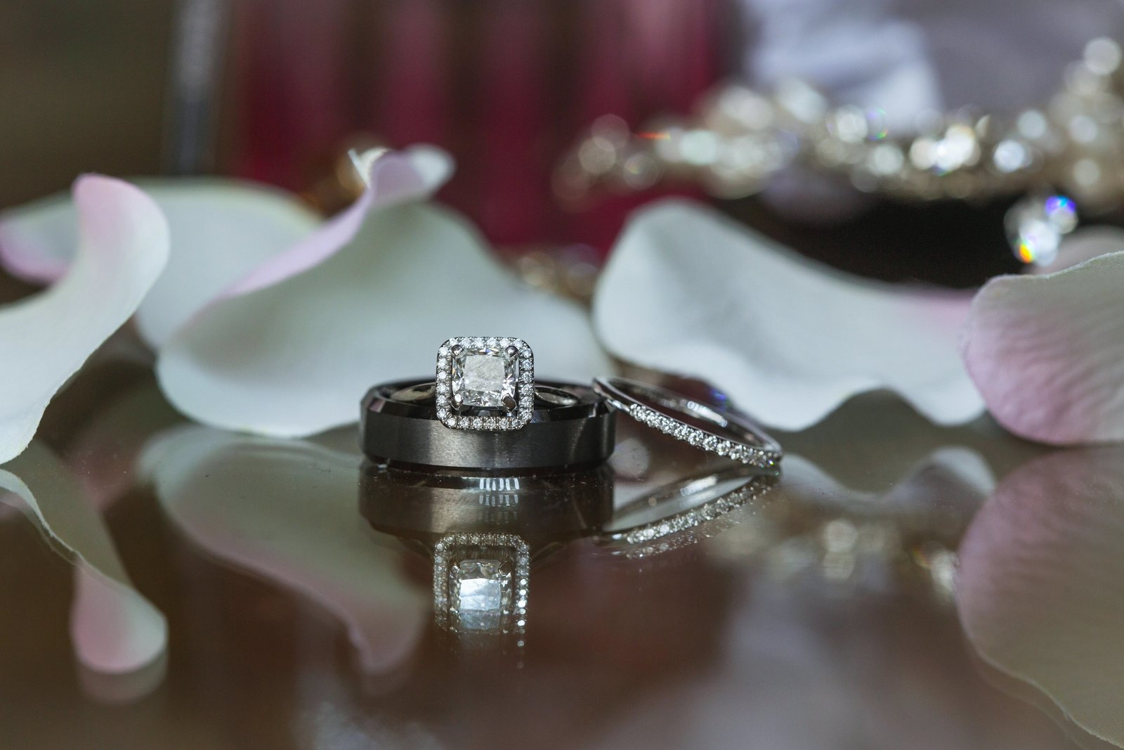 Newhall Mansion ring close up surrounded by white rose petals
