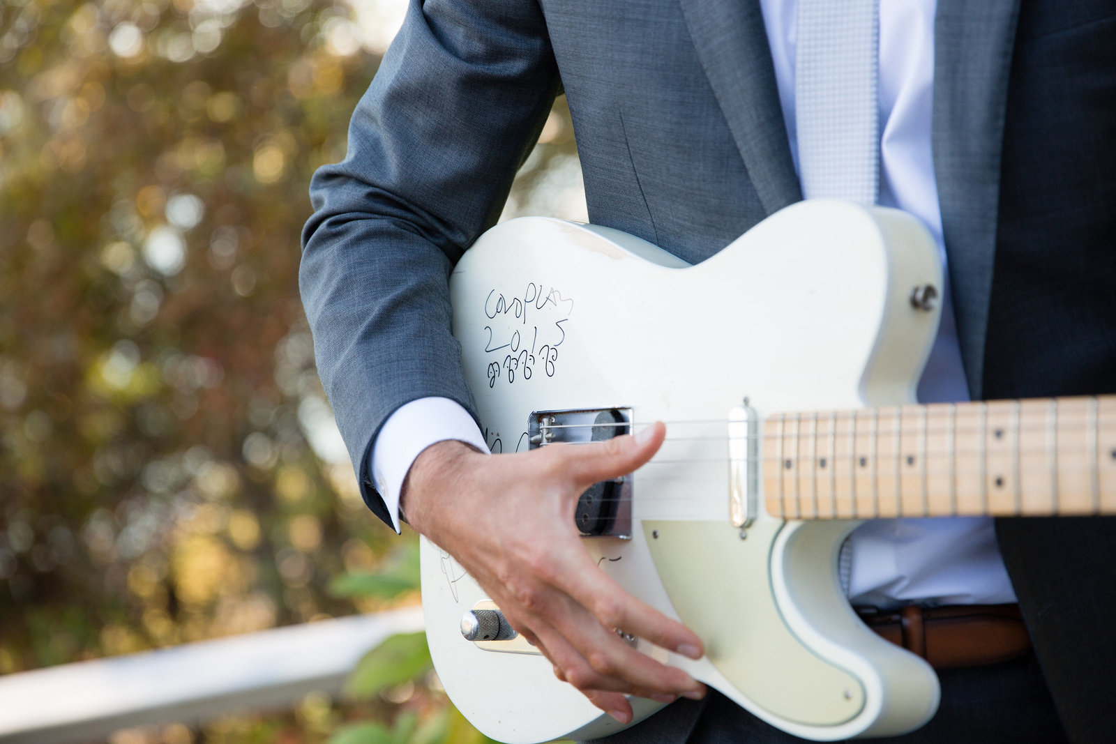 A signed guitar by Chris Martin of Coldplay for Groom