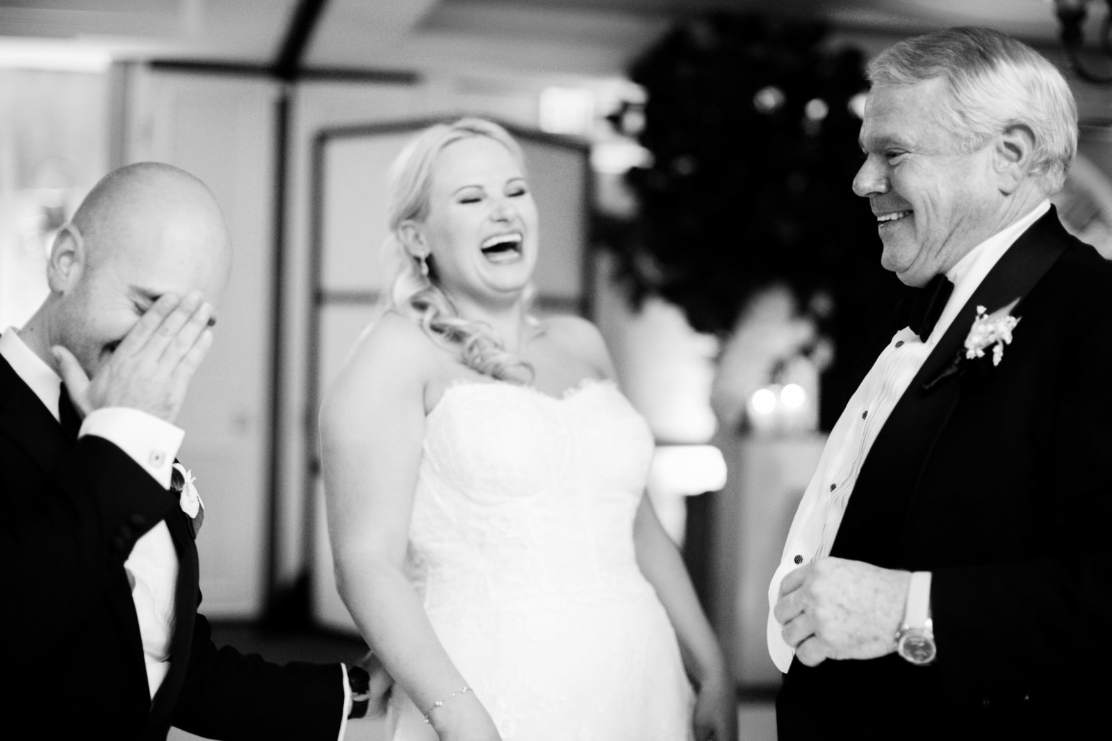 bride and groom laughing at luxury wedding reception