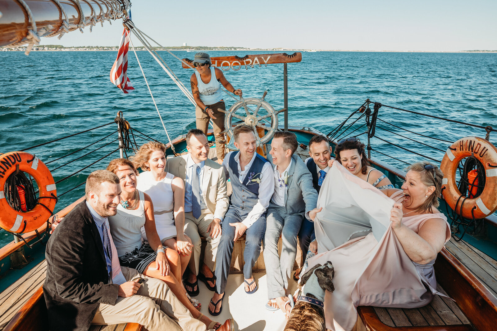 friends laugh on a yacht after eloping