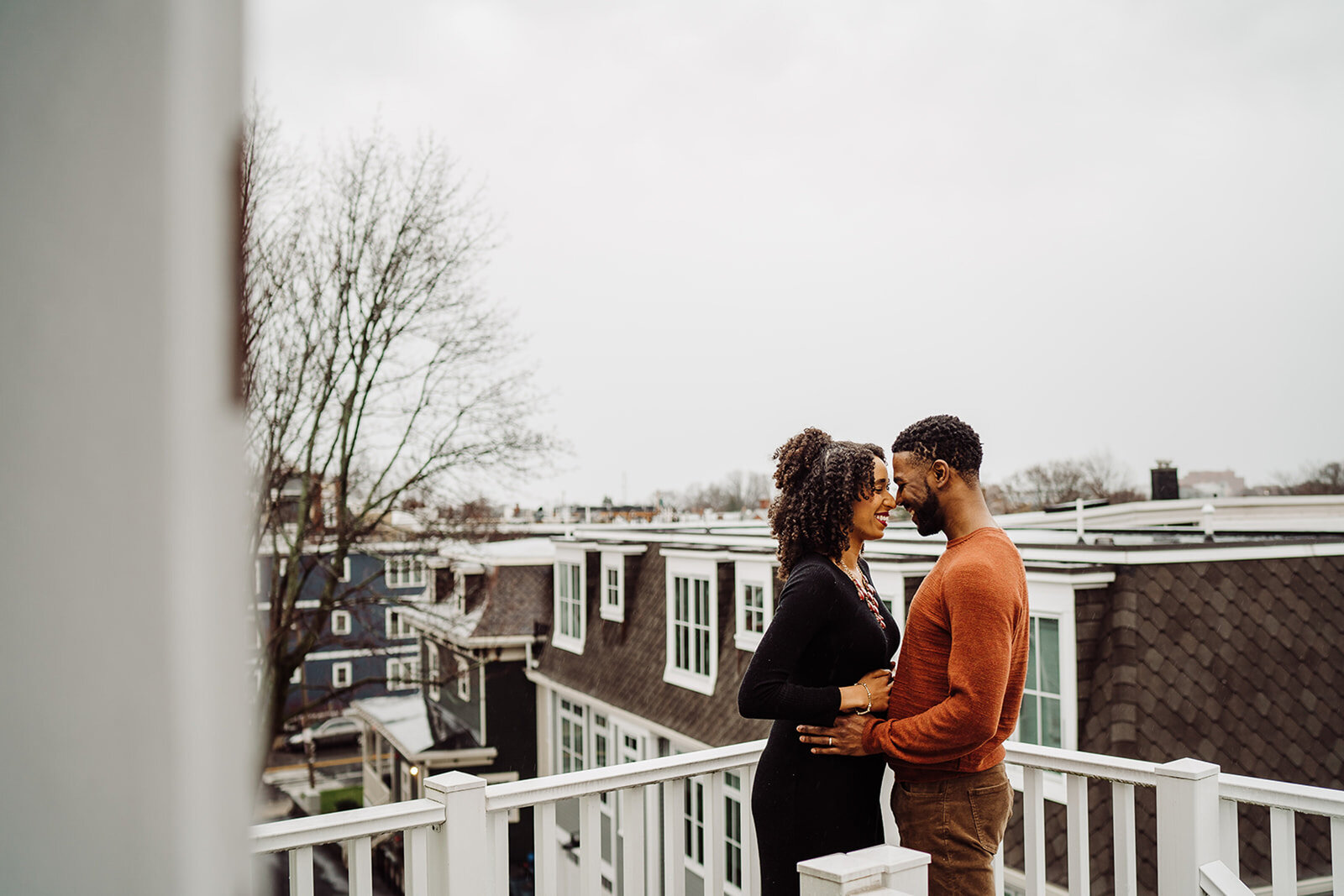maternity session on rooftop deck overlooking boston