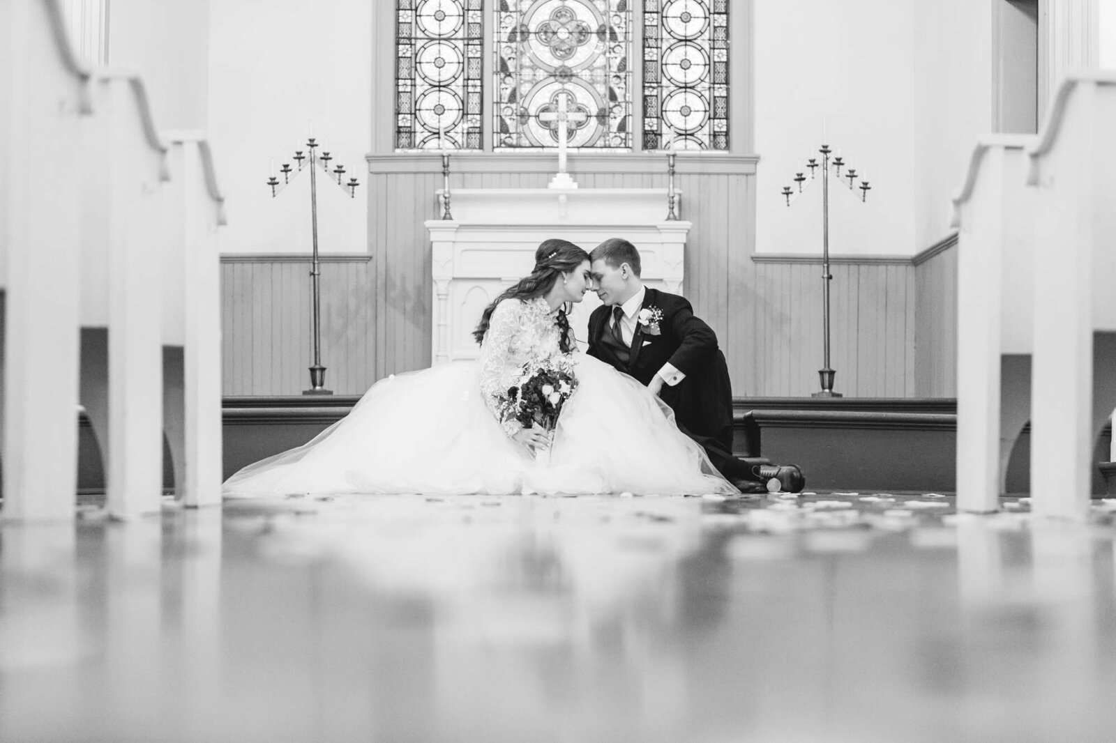 bride and groom sitting on church alter ohio wedding photographer