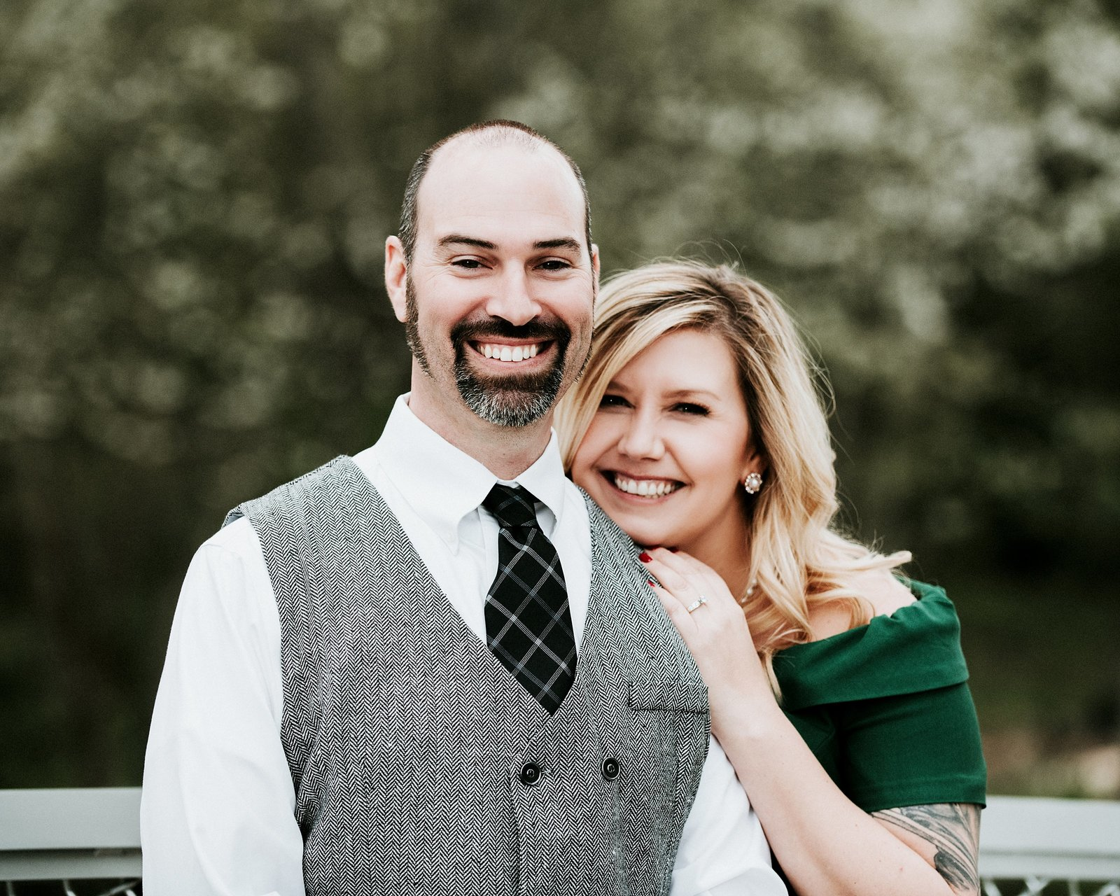 Couple cuddling and smiling at camera by Cle Elum Engagement Photographer