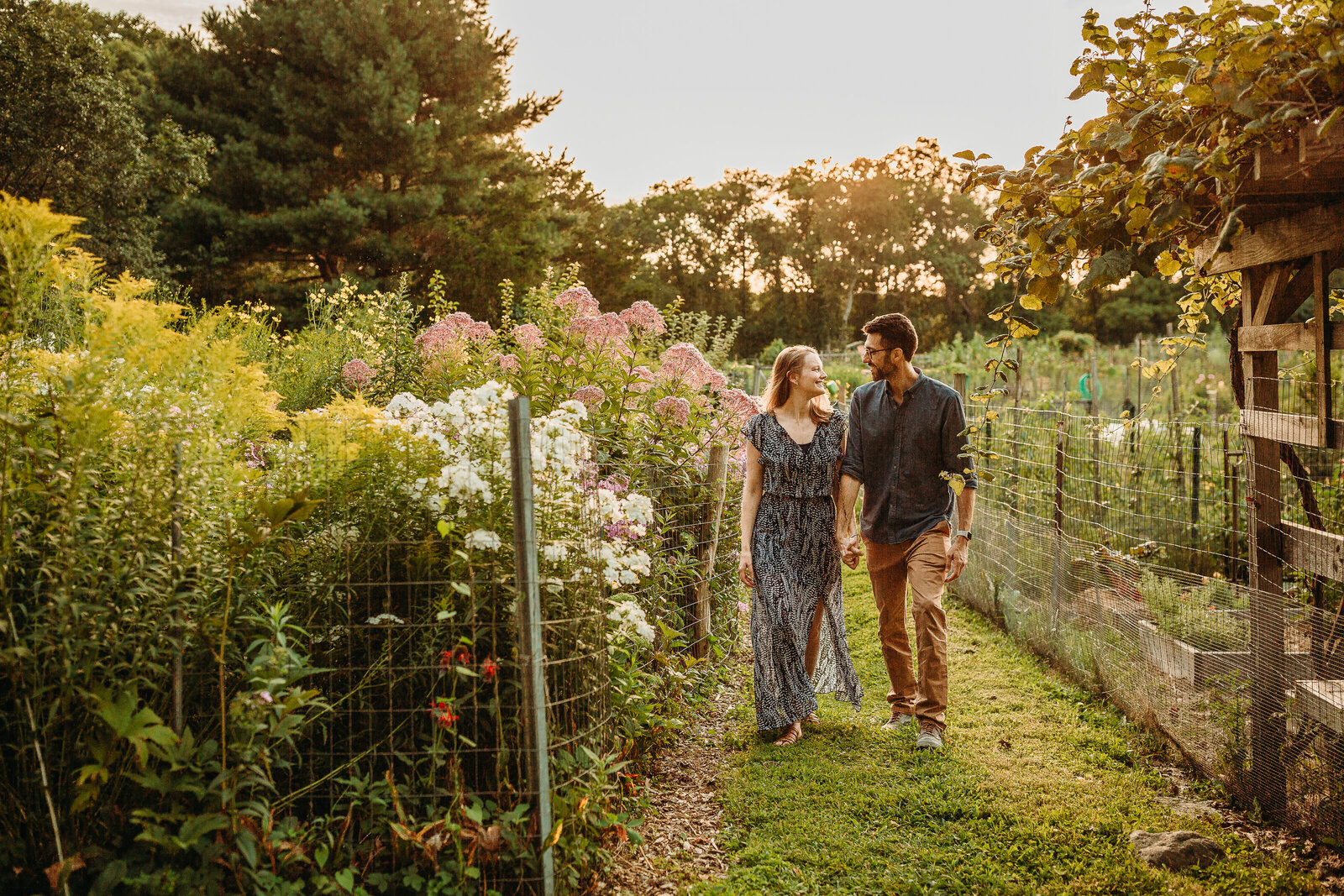 couple walks in a garden at sunset in boston