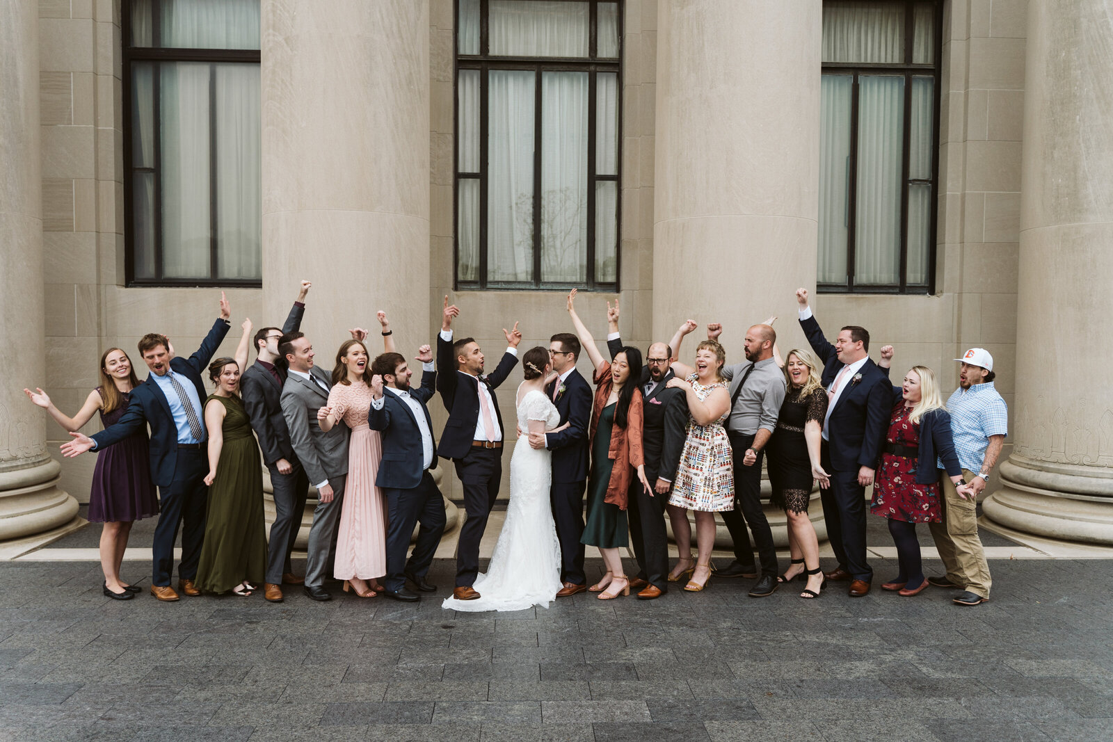 Large group of wedding guests pose at Nelson Atkins