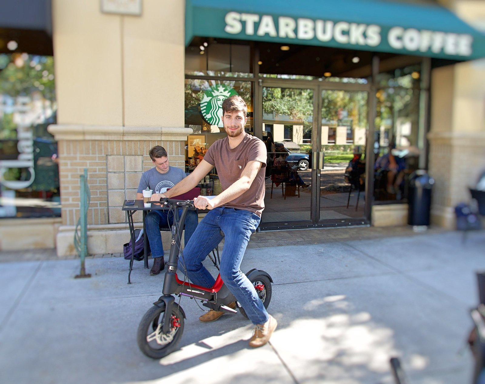 Student riding Red Go-Bike M3 to Starbucks Coffee