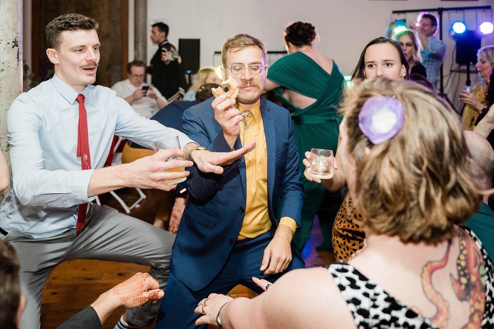 Wedding guest dances with donut at The Bauer