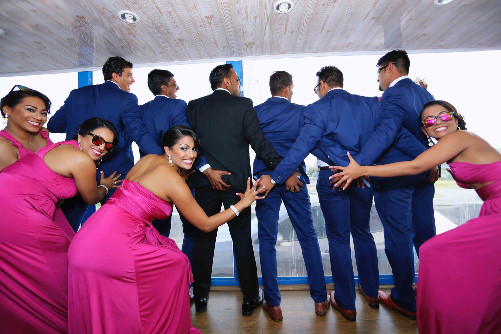 Cheeky wedding party pose. Photo by Ross Photography, Trinidad, W.I..