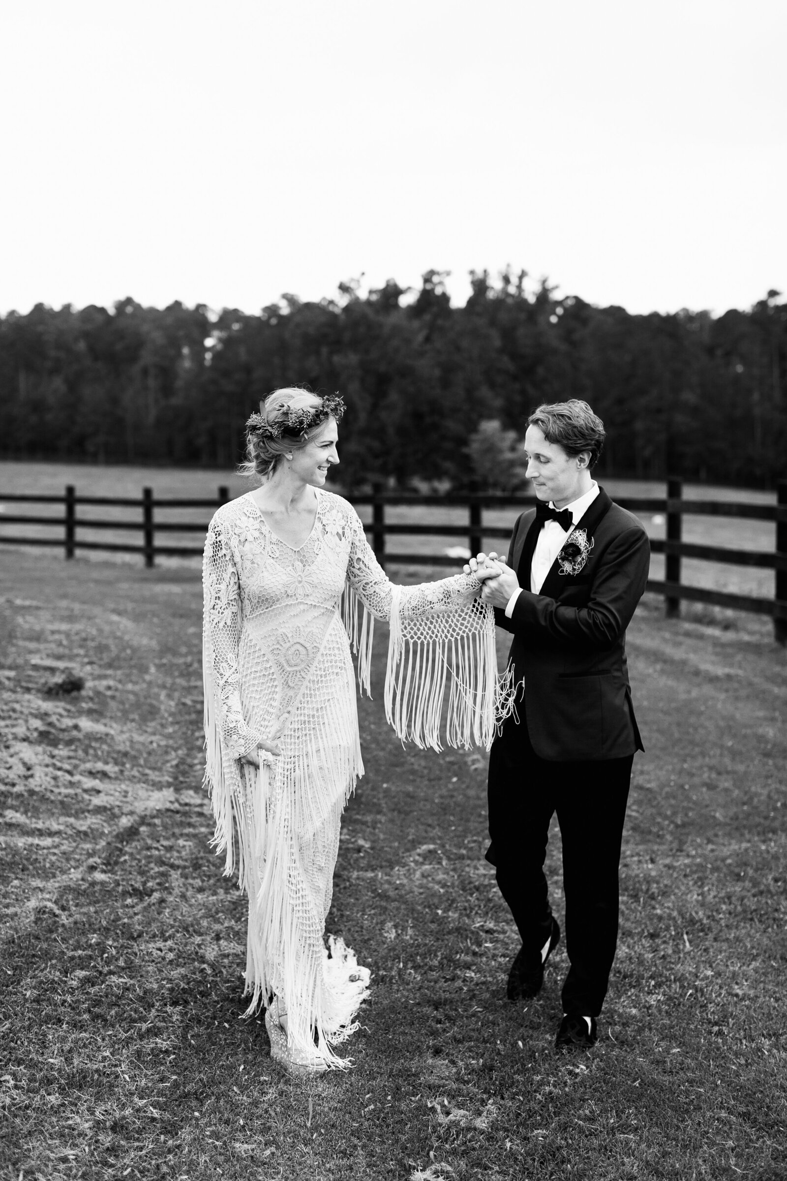 groom holding brides hand at farm