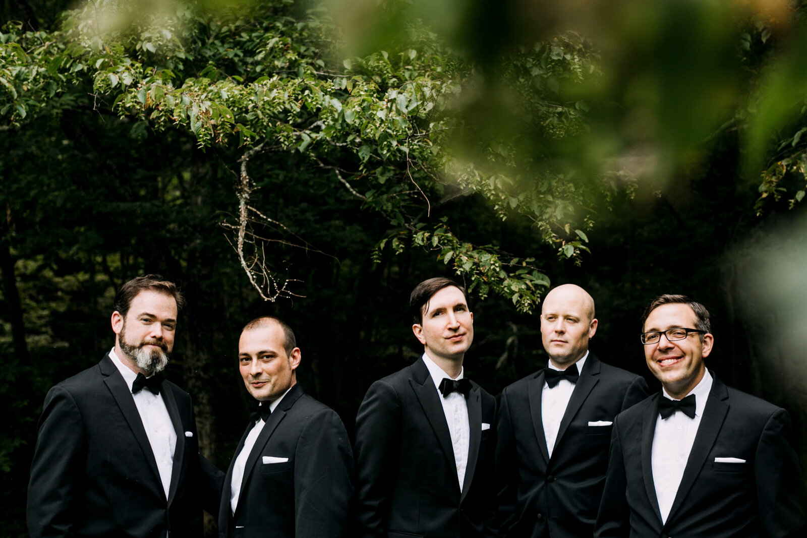 groomsmen in tux woods nature