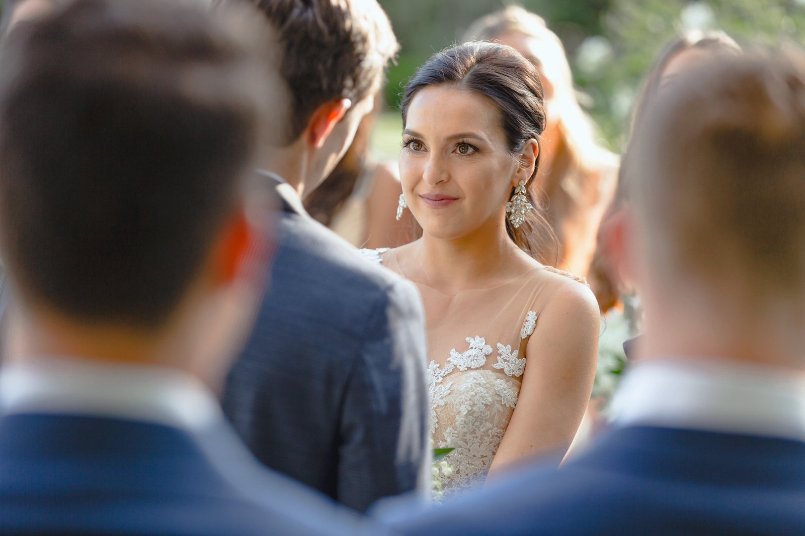 bride looking into grooms eyes during wedding ceremony at the newhall mansion