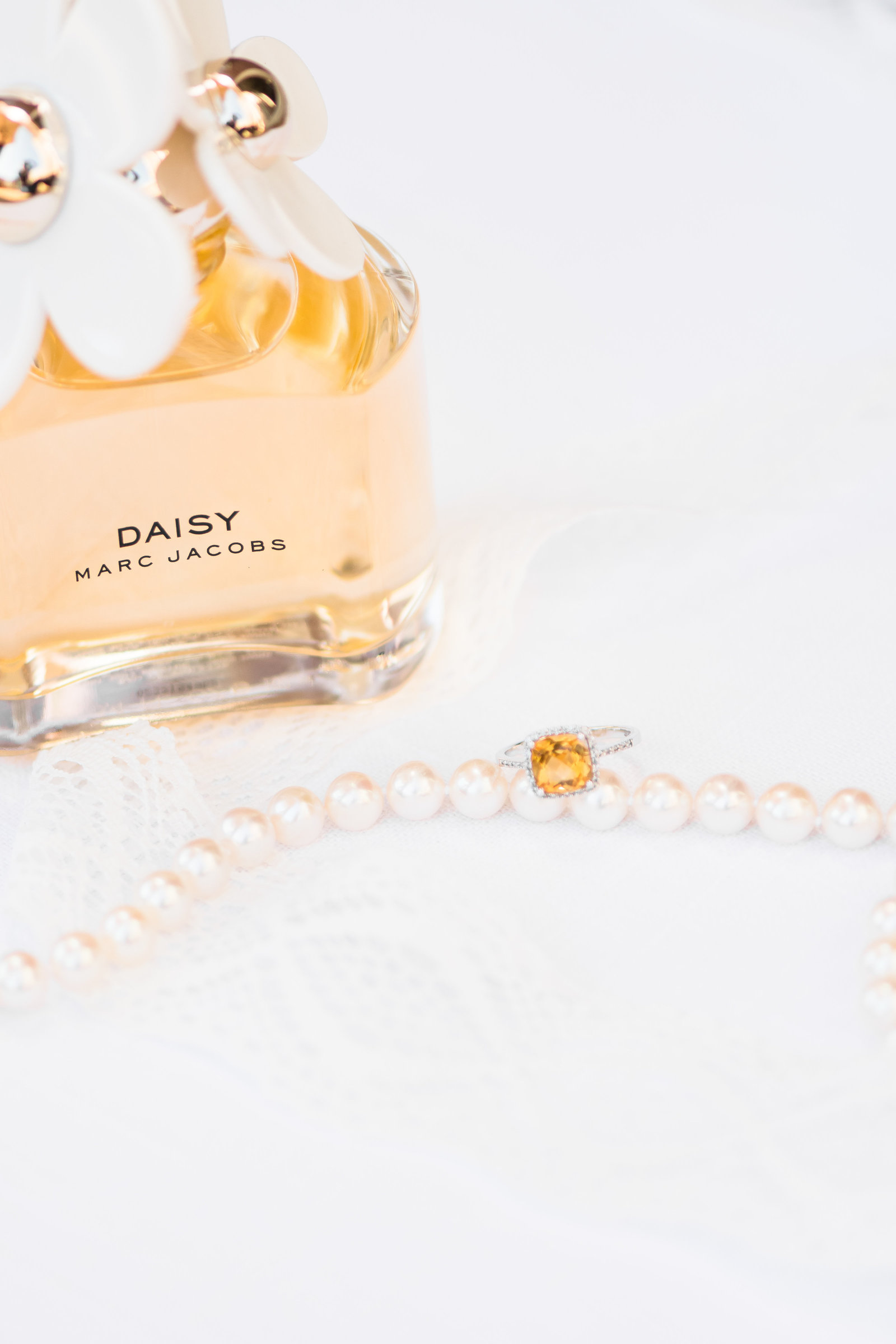 Charlotte lifestyle photographer shot of pearls and diamond ring