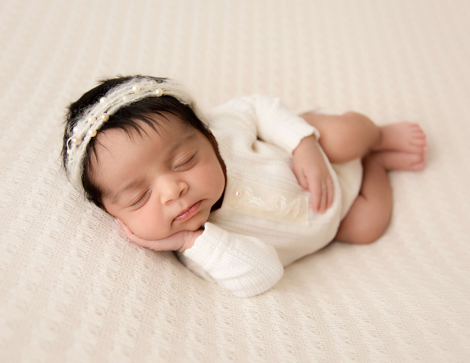 Gorgeous newborn baby girl posed in our Rochester, Ny studio.