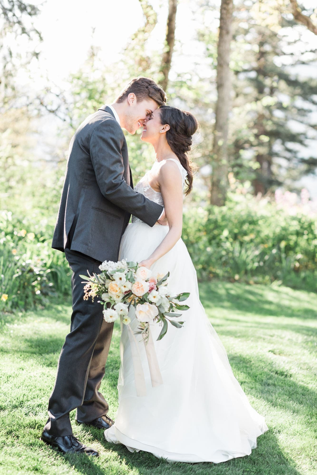 Bride and groom happily embrace at the Columbia Gorge Hotel in Oregon