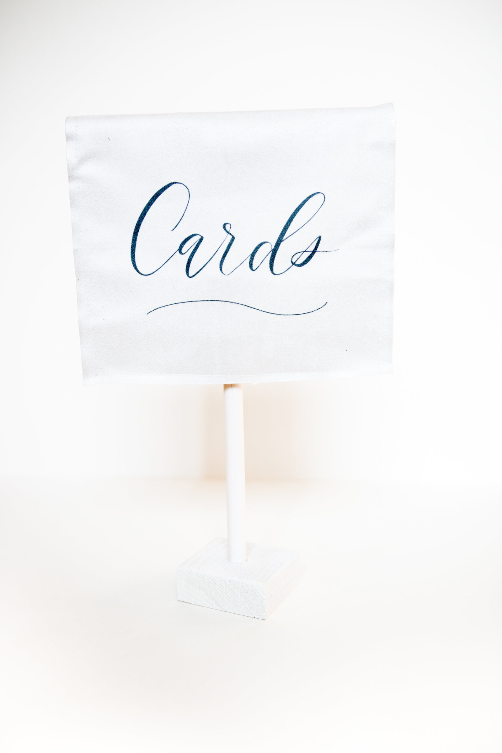 White self standing velvet with blue calligraphy card sign for weddings or events