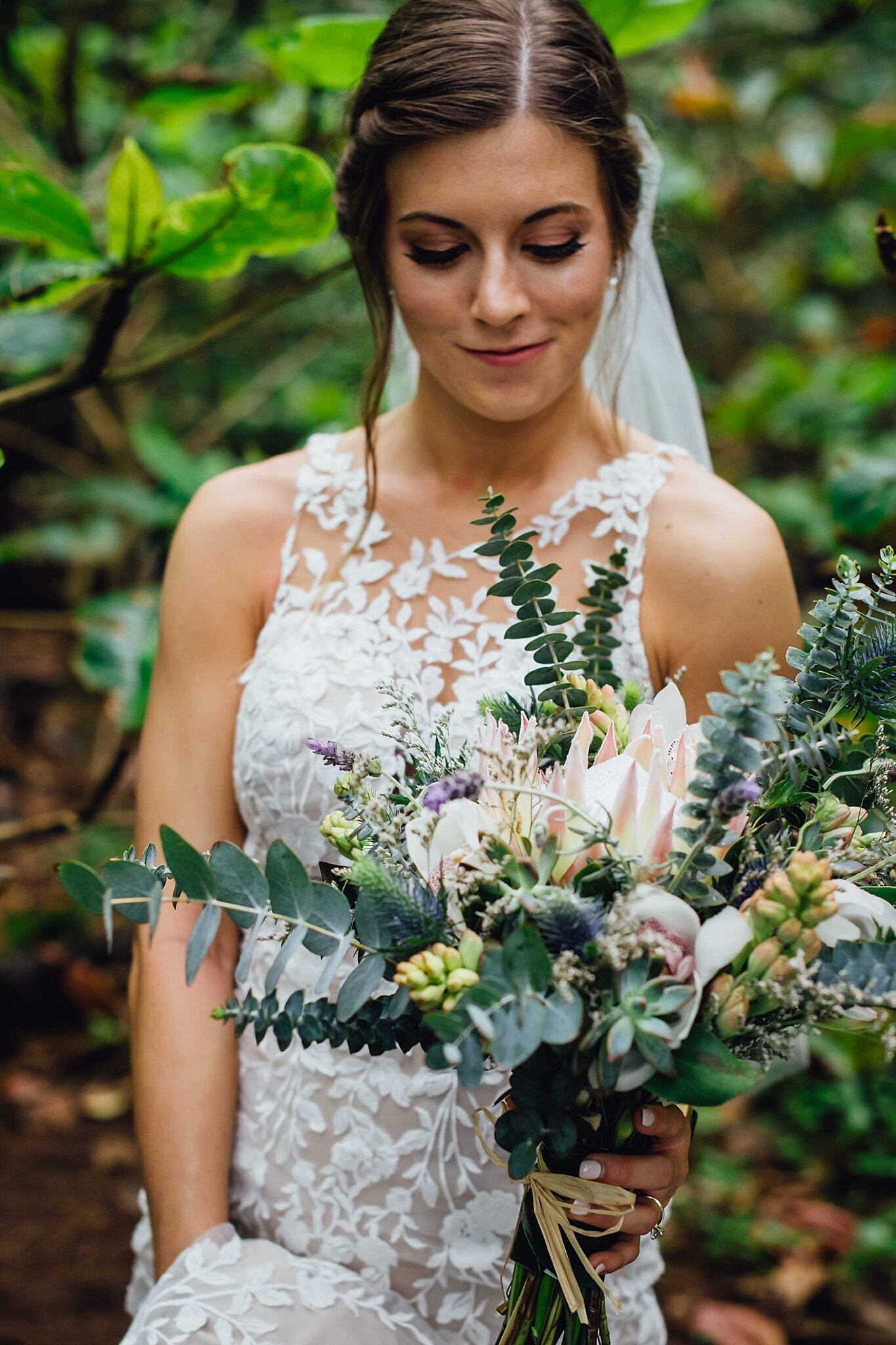 bride with gorgeous succulent wedding florals