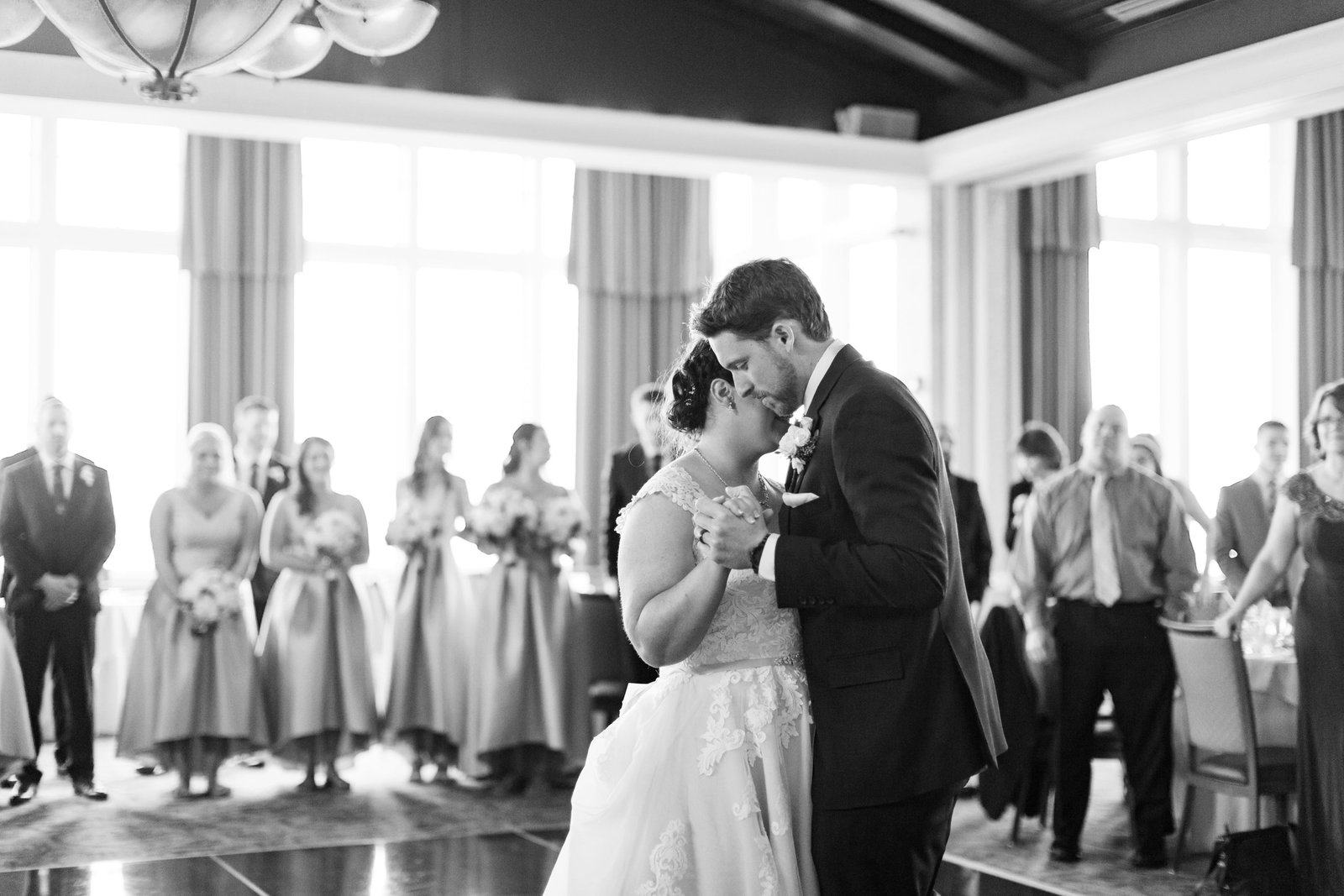 black and white image of bride and groom during first dance