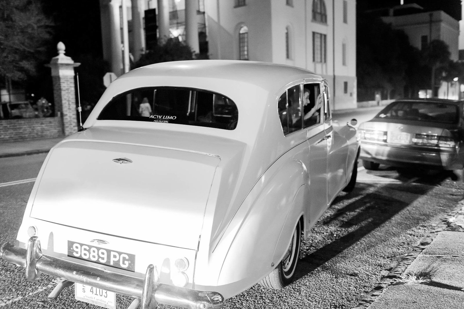 Bride and groom exit to their vintage Rolls Royce, Hibernian Hall, Charleston, South Carolina